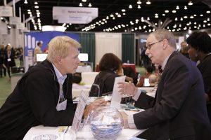 Joseph McInerney (right) discusses ASHG programmes with Dr Hudson Freeze